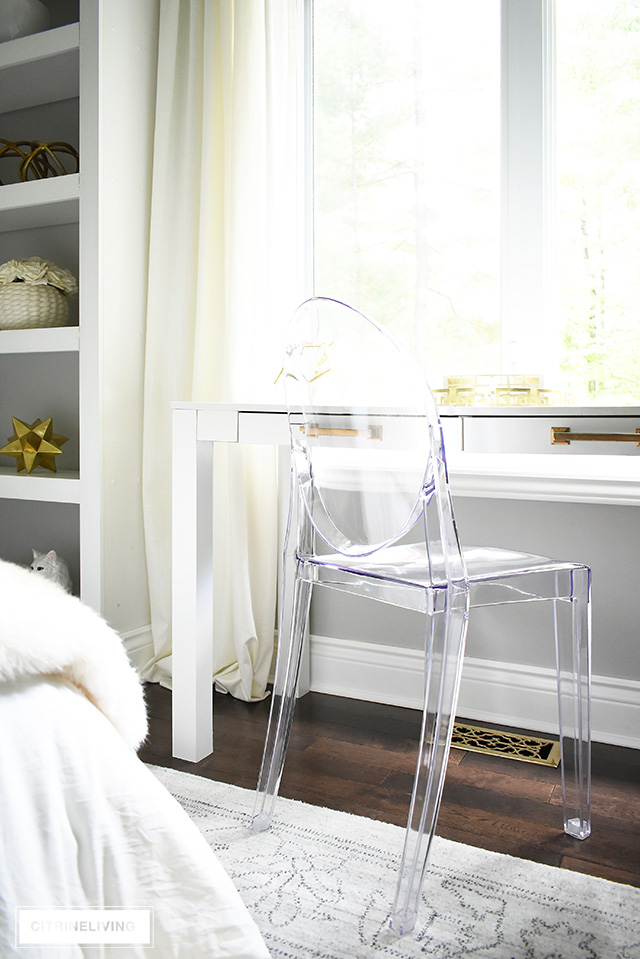 This fashion-forward Louis Ghost chair is the perfect piece to glam on this teen girl bedroom!