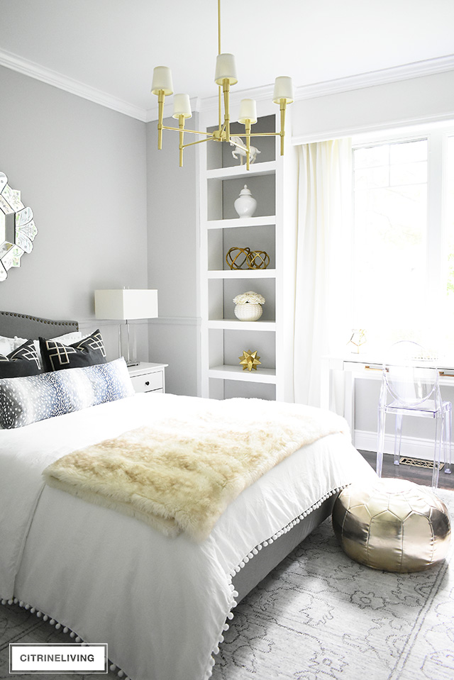 Gorgeous teen girl's bedroom with a soft gray, white and gold color palette for a chic and fashion-forward feel.