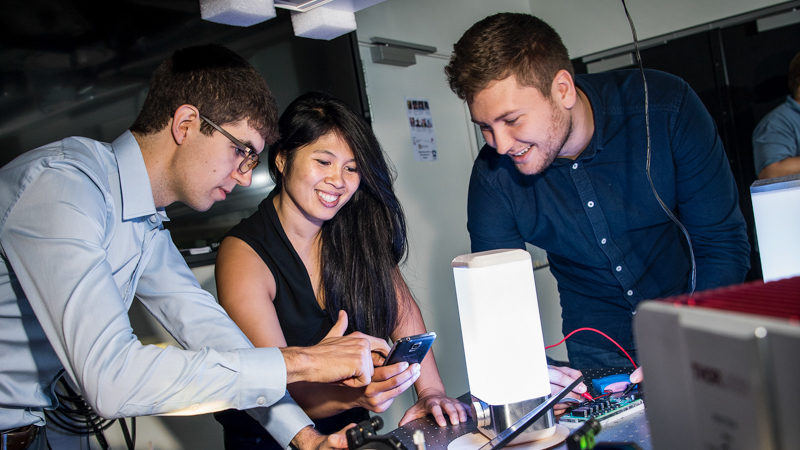 Mai Nguyen and team with Optoceutics device
