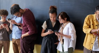 Group of young people on their phones
