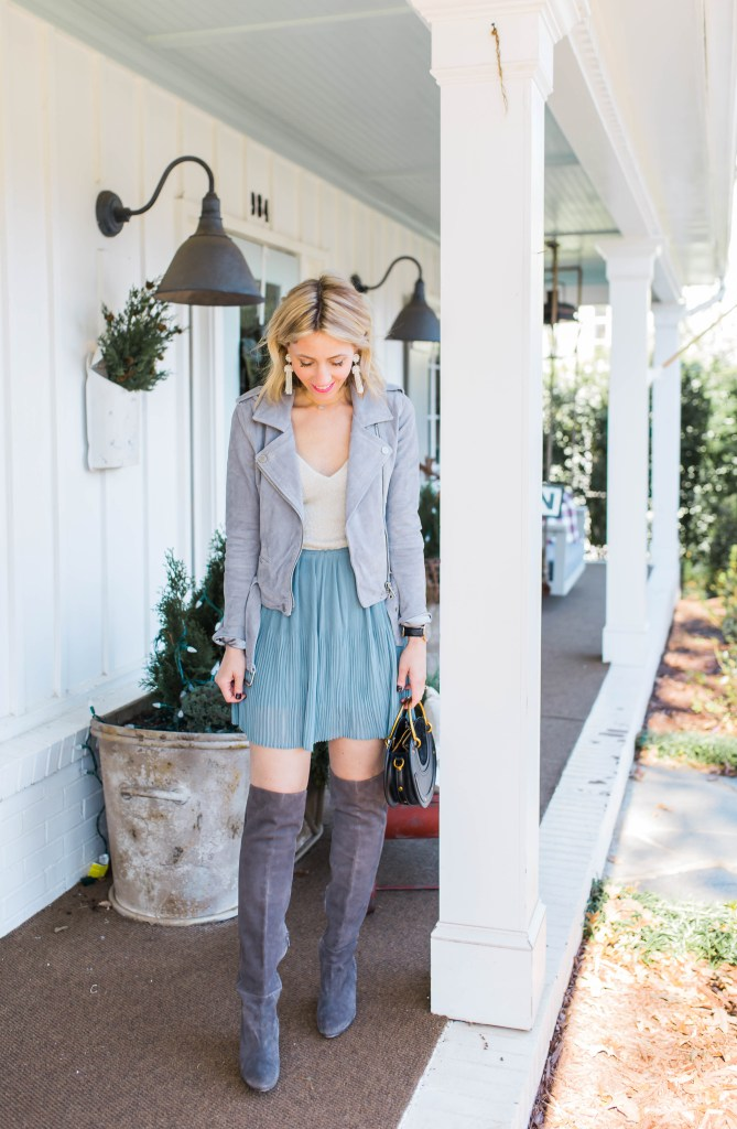 slouchy-sweater-staple-skirt-holiday-outfits-tassel-earrings-city-peach