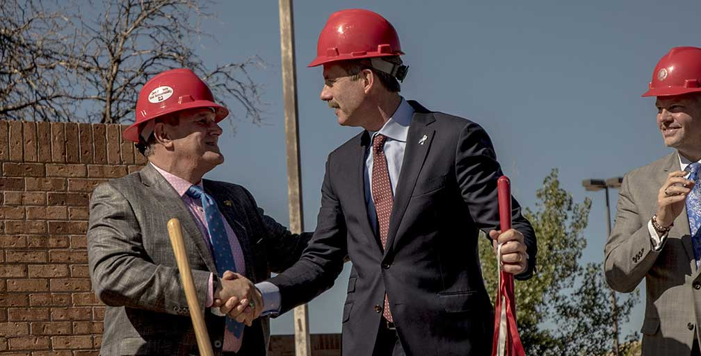 Mayor Berry shakes hands with developer