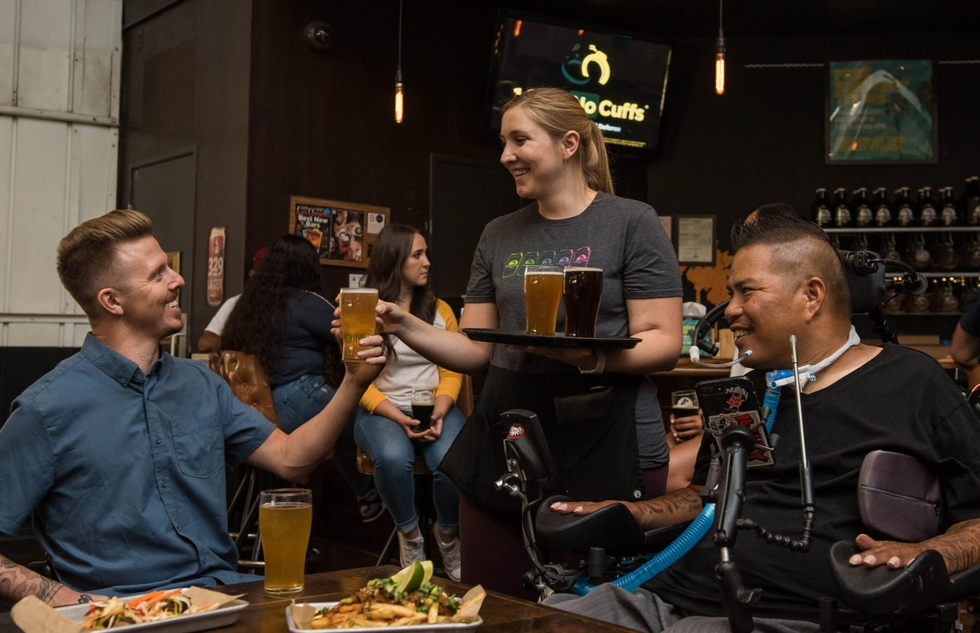 woman-serving-beer-at-a-bar-3009793