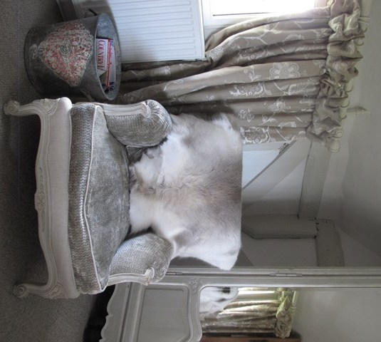 sheepskin rug on chair wheelchair price reindeer hide rugs – perfect sofa throws | cowhide & hides city cows blog