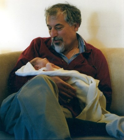 Ann Imig's father Ed cradles his grandson. Lessons mom