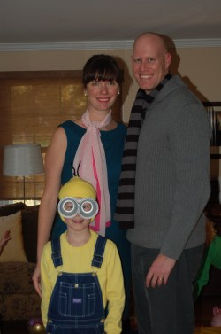 """Minion Philly Dads Group co-organizer Chris Bernholdt dressed as Gru. his wife Susie as Lucy, and his son Adam as minion from the movie """"Despicable Me 2"""" for Halloween in 2013."""