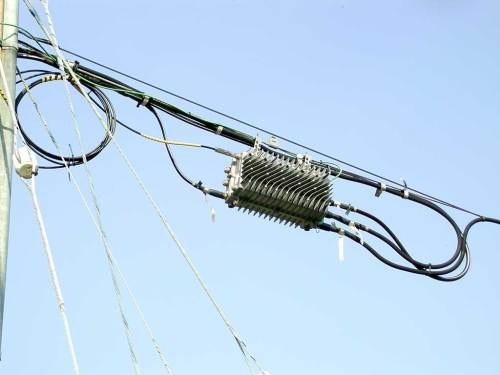 small resolution of this is an aerial optical node the fibre enters at the left top and there are three trunks exiting at the right side trunk cables are thicker than line