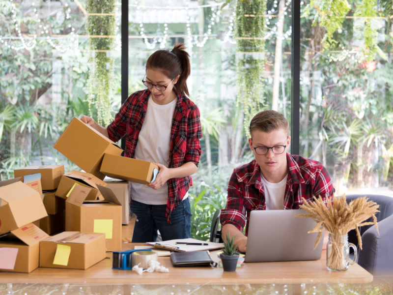Small business owners packing boxes