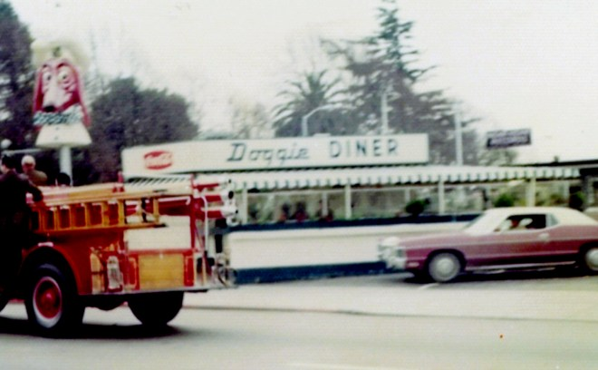 The former Doggie Diner location on C Street at Mission Boulevard as it appeared circa 1975. The historic 1923 Seagrave fire engine is visible in the photo at left. Both the 1923 Seagrave engine and an original Doggie Diner statue were present for the ground breaking celebration at this location forty years later on October 3, 2015. Image courtesy of Hayward Area Historical Society.
