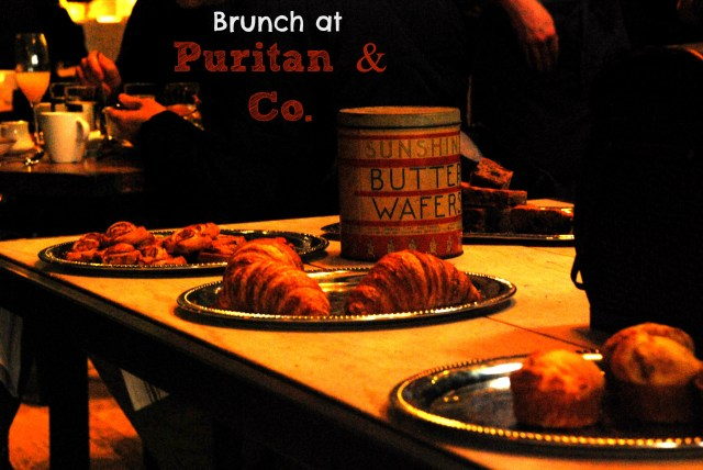 The brunch centerpiece or the entire dining room is a large table set with trays of pastries.