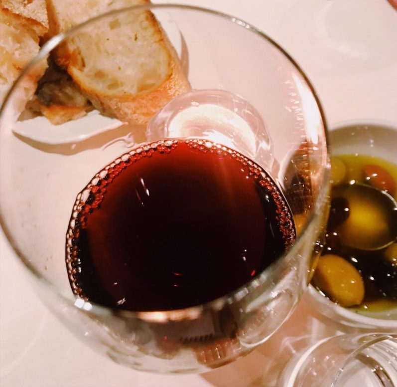 Proemio wine, olives and bread.