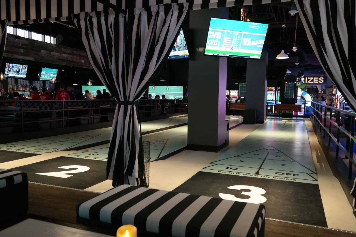 At Lucky Strike Social, book a cabana and shuffleboard court and you can still watch the Red Sox game too!