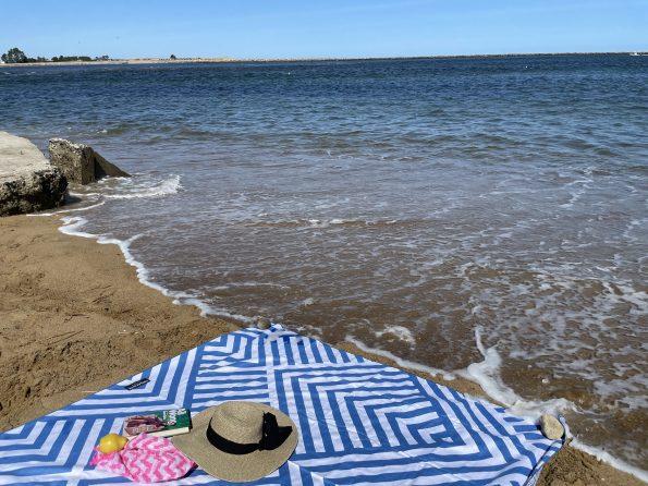 Tesalate beach towel by the ocean