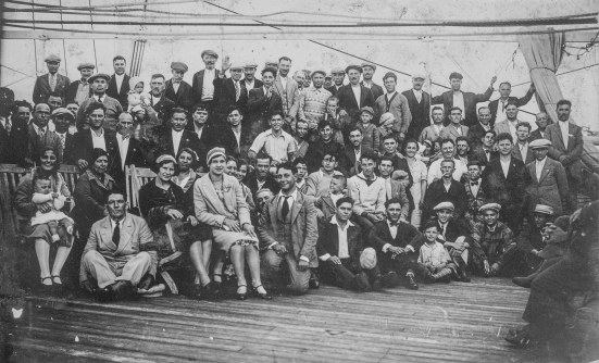 Group photo of the Scrivano family and other Italian immigrants on the deck of a ship on route to Canada. The family comprised four brothers and three sisters. Two sisters had already immigrated to Edmonton and one of them, Assunta Gaudio, sponsored Salvatore (Sam) Scrivano. Sam made the journey to Edmonton in January 1923, with a sister and her friend. Shortly after his arrival, a brother-in-law got him a job with the CNR, where he worked for 42 years. While in Italy in 1925, Sam met a young woman named Maria and they got married. They moved back to Edmonton and started a family, having three children: Mario, Ilda, and Elda. Image courtesy of the Provincial Archives of Alberta A10881.