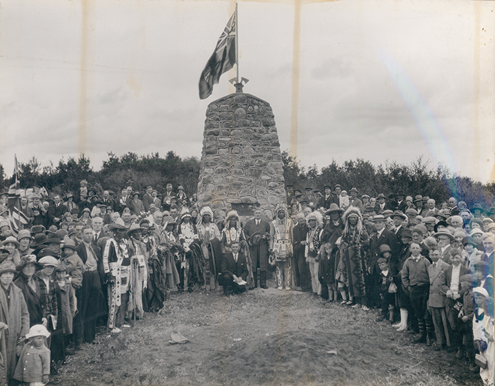 Cairn commemoration of peace treaty between the Cree and Blackfeet Aboriginal tribes c. 1927. Individuals identified in the photograph include Chief Erminskin, Chief Louis Bull, Chief Rabbit Skin, and Chief Samson as well as John Blue and Hugh John Montgomery. Image courtesy of the City of Edmonton Archives EA-10-2503.