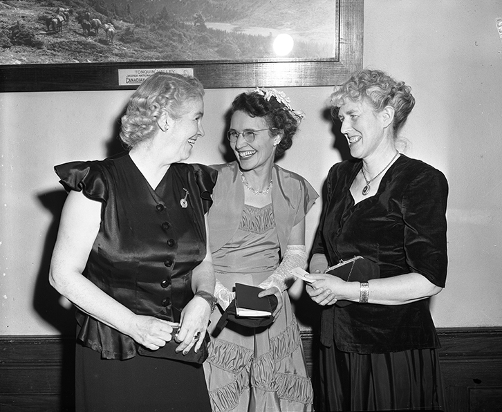 University Women's Club meeting. Mrs. C.C. Higgins, Mrs. Roy Anderson, Mrs. Morden H. Long photographed by Eric Bland on February 20, 1950. Image courtesy of the City of Edmonton Archives EA-600-3894.