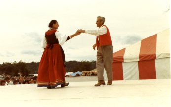 Heritage Festival at Hawrelack Park. Two people dance on a stage before an audience at Edmonton's Heritage Festival. Image courtesy of E. R. Cavaliere, supplied by Adriana A. Davies.
