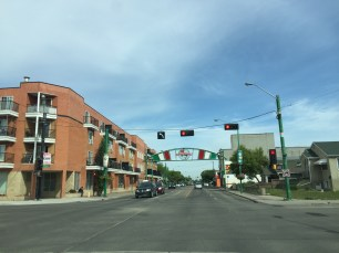 Little Italy Benvenuti (Welcome) Sign along 97 Street and 107 Avenue in Edmonton, Alberta. Image courtesy of Adriana A. Davies