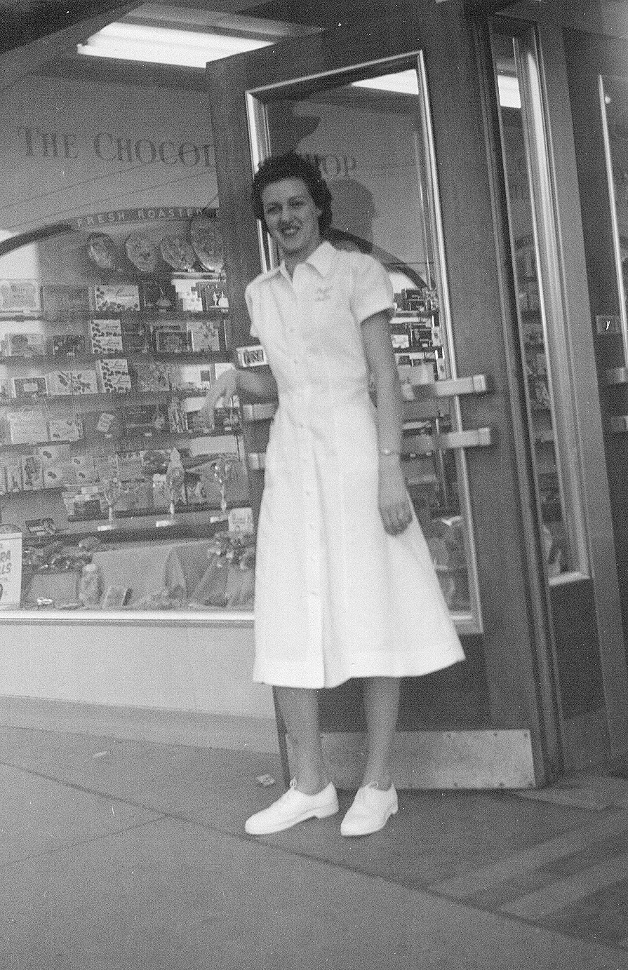 Shirley Herzog at the door of the Palace of Sweets, 1959. Photo courtesy of Lawrence Herzog.