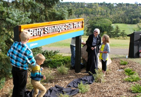 The opening of the Betty Stanhope-Cole park and Betty with her three grandchildren who helped unveil the new sign. The Highlands Golf Club is visible in the background. Photo courtesy of Ted Smith, 2011.