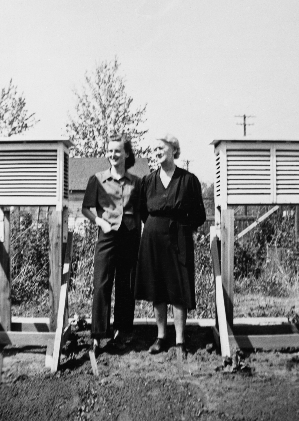 Eda Owen, meteorologist, and granddaughter Pam, Edmonton, Alberta circa 1940-1949. At top of McDougall Hill. Image courtesy of the Glenbow Archives na-4844-21.