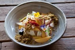 Frozen yoghurt parfait, fresh stone fruit salad and pistachio crumble.