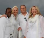 Richard and Melinda Kibukamusoke with Scott Hamley amd Carol Scott.