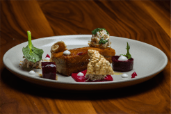 As sexy as chef Clement's accent… caramelised pork belly with house-made celeriac remoulade, coconut mayo, beetroot and cashews. Photo by Gary Schafer