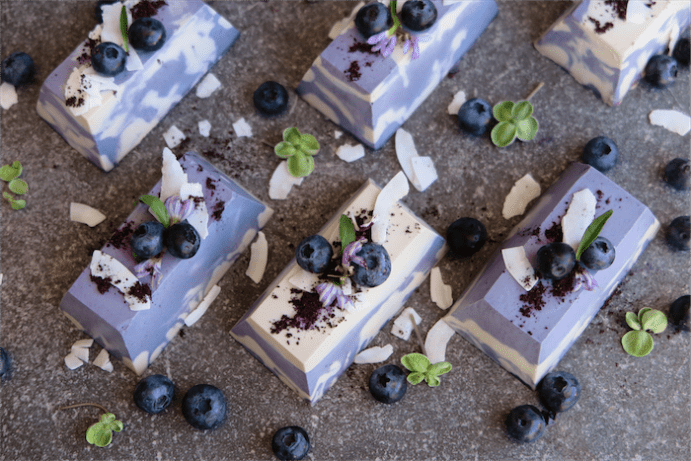 Raw white chocolate and blueberry mini cheesecakes.