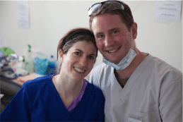 "Canberra dentist Tara McAndrew and husband Brian at work in the Himalayas… ""My husband learnt a lot and a lot more about dentistry,"" says Tara."