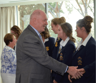 Sir Peter and Lady Cosgrove presenting an award to The Gold Angels from Merici College
