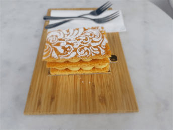 """Vanilla bean Mille Feuille with an icing sugar pattern dusted on top… the puff pastry was """"divine"""". Photo: Wendy Johnson"""