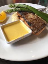 The crispy-skin salmon served with lime mash, asparagus and hollandaise sauce. Photo: Wendy Johnson