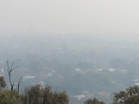 You have to look carefully, but to the left in this smoky vista taken today (December 8) from Red Hill is Parliament House.