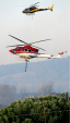 Choppers in action fighting the Pialligo fire. Photo: Andrew Campbell.