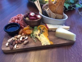 Grazing boards… loaded with Jensen's aged-cheddar, Manchego cheese, a creamy pumpkin hummus and a carrot and coconut dip. Photo: Wendy Johnson