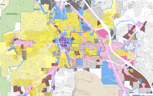 A zoning map of Marietta, GA. Yellow areas are zoned for single-family homes only; brown areas are set aside for apartments. The large brown area in the southeast corner contains apartments to be razed. Pink is commercial. Source: Marietta, GA website