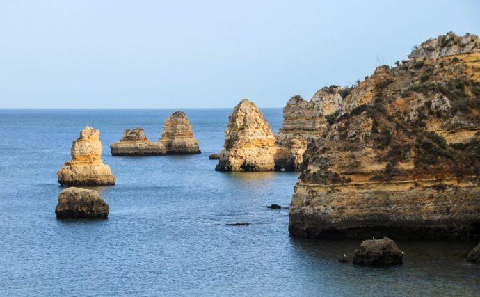 The cliffs of Praia do Camilo seen from Praia Dona Ana