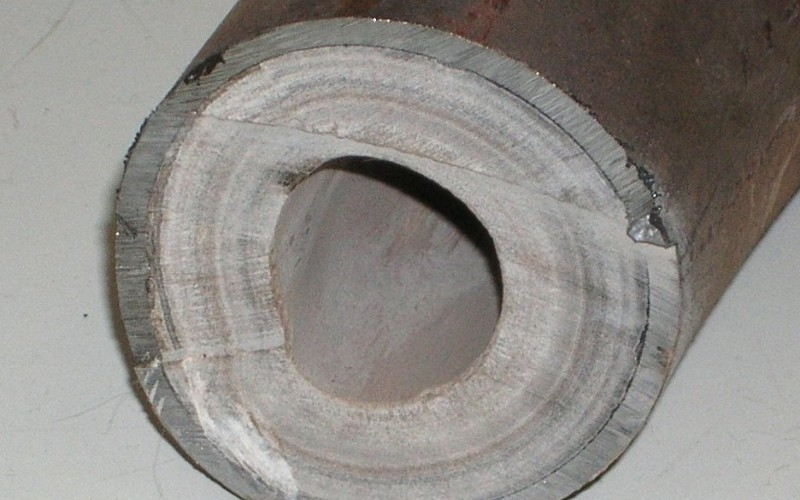 limestone buildup in pipe caused by years of hard water