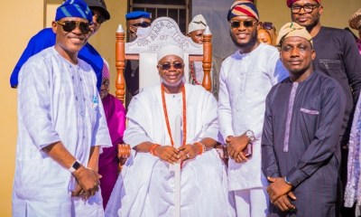 Alara of Ilara Kingdom, Oba Olukayode Olufolarin Ogunsanwo (center) with the Novarick Team, during the Ebi Festival celebrations in Epe