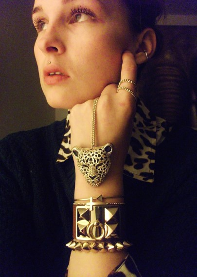 leopard necklace, vintage arrow bangle, cross chain, faux- hermes leather cuff, studded bracelet wearing maybelline great lash lots of lashes