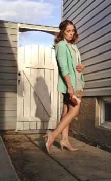 mint blazer, gold shorts, neutral accessories
