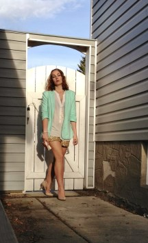 nude heels, gold sequin shorts, white top and mint blazer