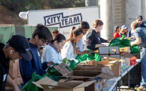 Volunteers pack groceries for neighbors at CityTeam