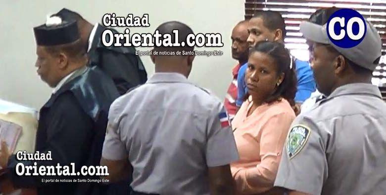 Los cuatros encartados al momento de ser puestos en custodia.