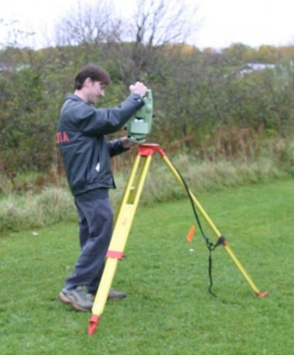 Putting total station on tripod