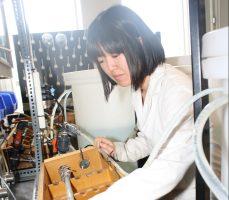 Aki Kogo (MASc Candidate) looks over the lead (Pb) pipe experimental setup in the Environmental Lab. (Credit: Keenan Dixon)
