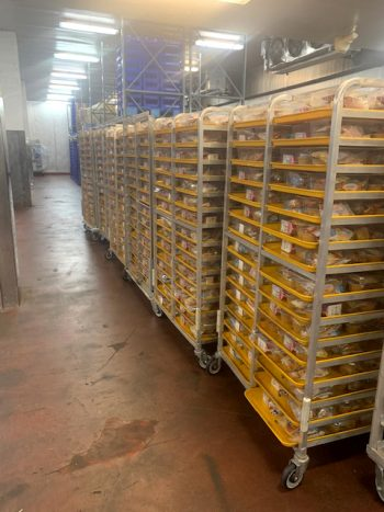 Take and prepare food that is ready to be distributed throughout Jefferson County, Kentucky. (Photo courtesy of Jefferson County Public School)