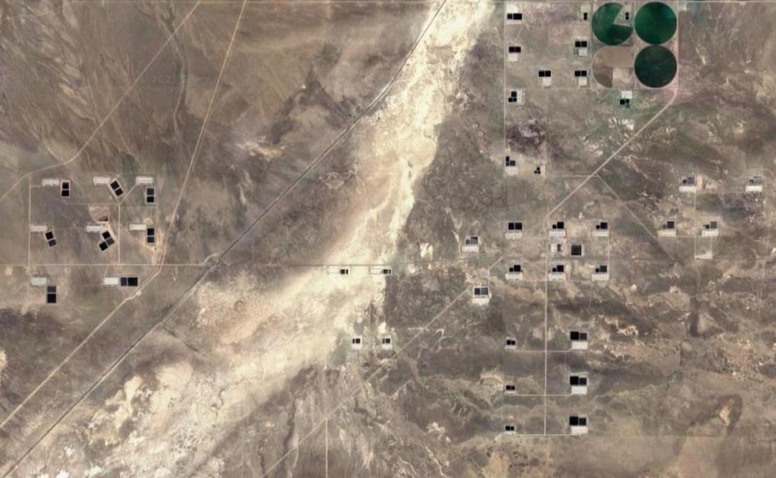 A screenshot of a Google Earth satellite view of hog farms in Beaver County, Utah.