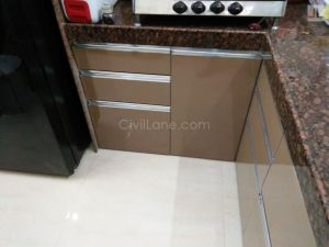 Tan Color Modular Kitchen High Gloss Laminate Finish Andheri Seven Bunglows (11)